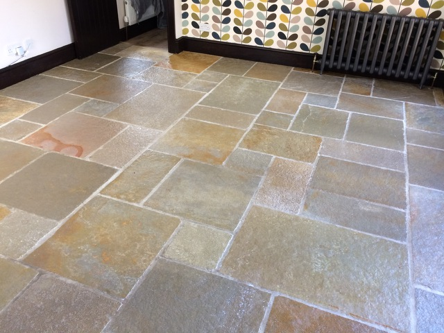 Stone floor cleaned and resealed by SJS
